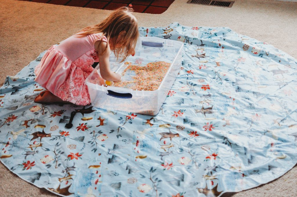 mom hack for reducing sensory bin messes