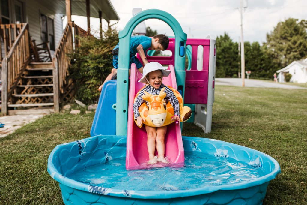 slide into kiddie pool; mom blogger; birthday party; non-toy gift ideas